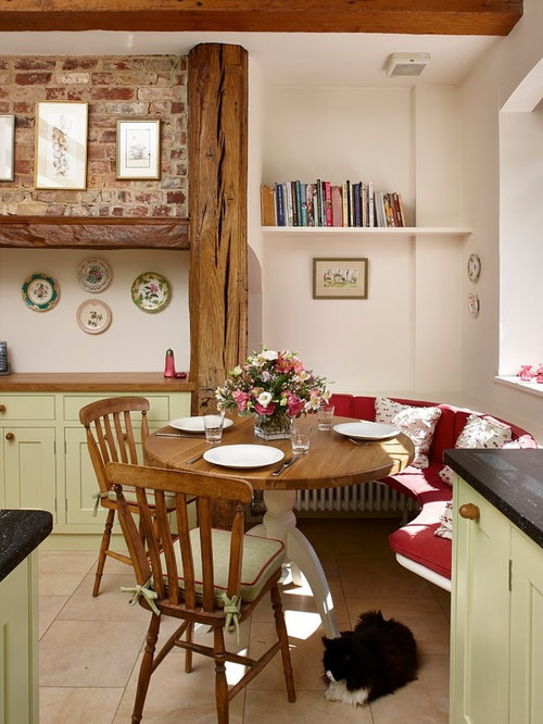 Small Farmhouse Kitchen Dining Combo Idea In Surrey With Limestone Floors And Beige Walls