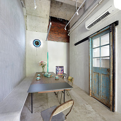 Urban concrete floor enclosed dining room photo in Singapore with gray walls