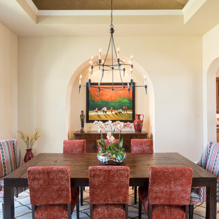 Example of a huge tuscan dark wood floor enclosed dining room design in Austin with beige walls