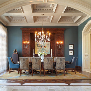 Example of a tuscan dining room design in San Diego with blue walls