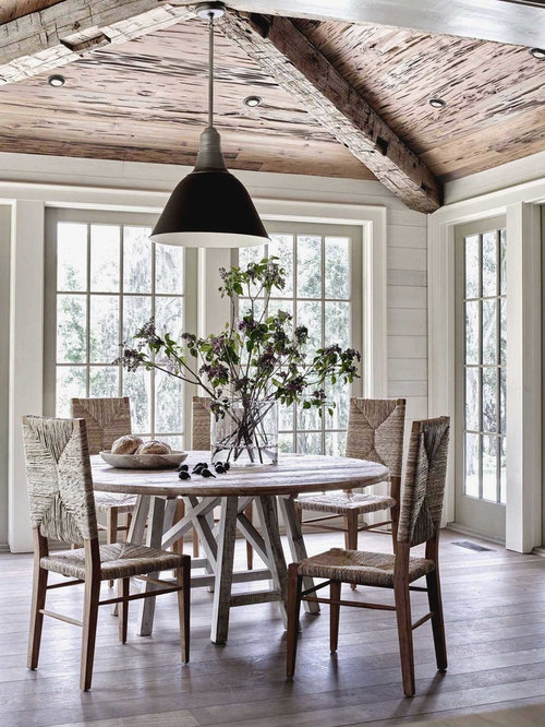 Inspiration For A Beach Style Dining Room Remodel In Other With Light Wood Floors And Beige