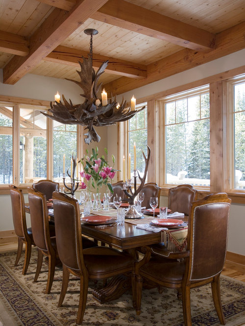 Inspiration For A Large Rustic Light Wood Floor And Brown Dining Room Remodel In Other