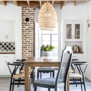 Kitchen/dining room combo - mediterranean concrete floor and gray floor kitchen/dining room combo idea in Sacramento with white walls