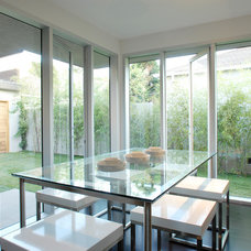 Modern Dining Room by Tocha Project