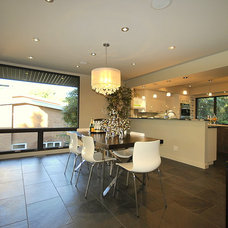 Contemporary Dining Room by Revealing Assets - Home Staging Services