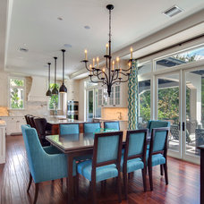 Tropical Dining Room by Clifford M. Scholz Architects Inc.