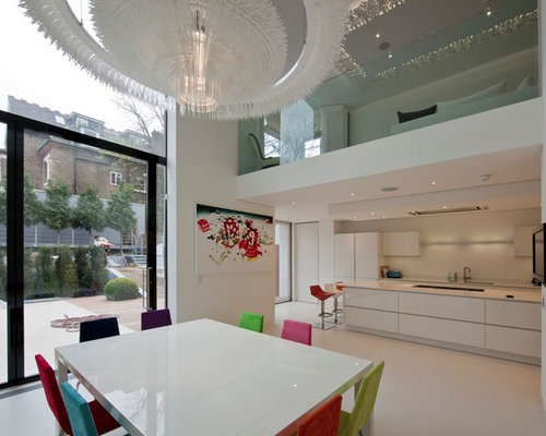 Trendy Kitchen Dining Room Combo Photo In London With White Walls