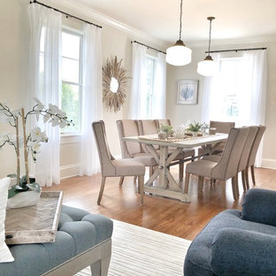Design ideas for a large nautical dining room in Other with white walls, medium hardwood flooring, a standard fireplace, a brick fireplace surround and brown floors.