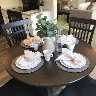 Ispirazione per una sala da pranzo aperta verso la cucina tradizionale di medie dimensioni con pareti grigie, pavimento in laminato e pavimento grigio