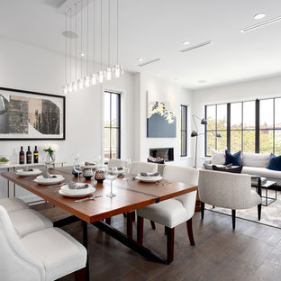 Inspiration for a mid-sized transitional medium tone wood floor and brown floor dining room remodel in Vancouver with white walls, a standard fireplace and a plaster fireplace