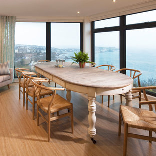 Design ideas for a coastal enclosed dining room in Cornwall with beige walls, light hardwood flooring and beige floors.