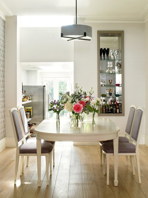 Inspiration For A Transitional Light Wood Floor Dining Room Remodel In  London With White Walls
