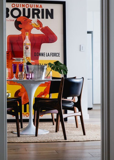 Midcentury Dining Room by The Den Interiors