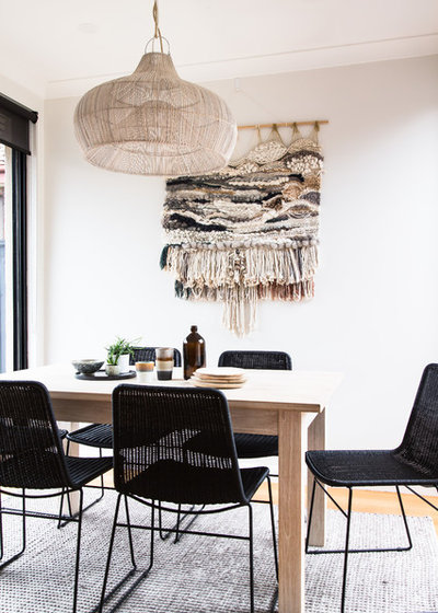 Beach Style Dining Room by The Den Interiors