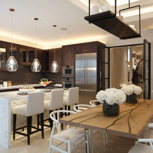 This is an example of a medium sized traditional kitchen/dining room in London with white walls and white floors.
