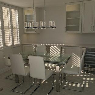 Ejemplo de comedor minimalista, pequeño, abierto, con paredes blancas y suelo de baldosas de porcelana