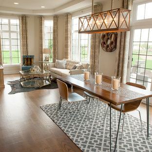 Inspiration for a large transitional medium tone wood floor and brown floor great room remodel in Milwaukee with white walls and no fireplace