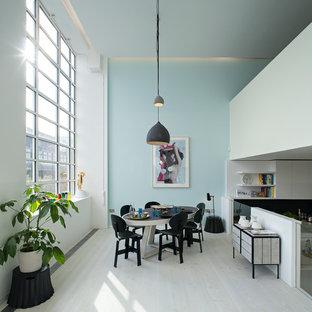 Great room - scandinavian light wood floor great room idea in London with blue walls