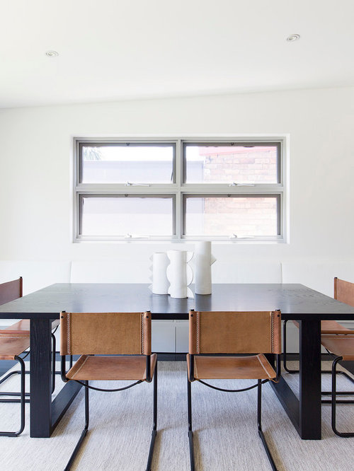 Photo Of A Mid Sized Modern Open Plan Dining In Sydney With White Walls
