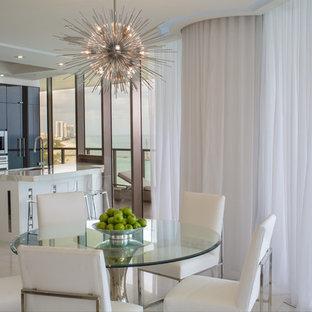На фото: кухня-столовая среднего размера в современном стиле с мраморным полом, горизонтальным камином, фасадом камина из камня и белым полом с