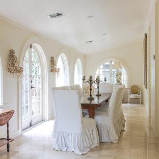 ニューオリンズの中くらいのシャビーシック調のおしゃれな独立型ダイニング (白い壁、ライムストーンの床、暖炉なし、ベージュの床) の写真