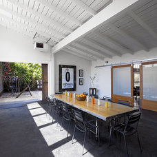 Industrial Dining Room by Malcolm Davis Architecture