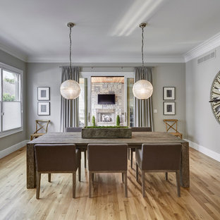 This is an example of a large country dining room in Detroit with grey walls, light hardwood flooring and no fireplace.