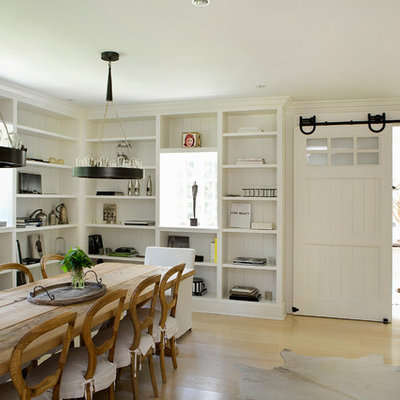 Inspiration for a large country light wood floor and beige floor dining room remodel in New York with white walls and no fireplace