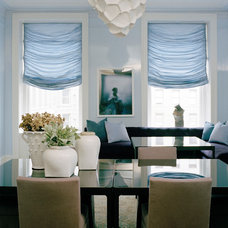 Transitional Dining Room by Rizzoli New York