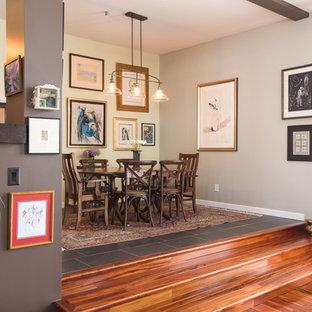 Imagen de comedor clásico renovado, de tamaño medio, abierto, sin chimenea, con paredes grises, suelo de pizarra y suelo gris