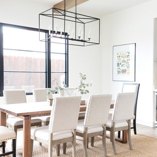 Example of a tuscan medium tone wood floor and brown floor dining room design in Los Angeles with white walls
