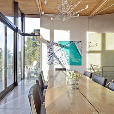 Beach Style Dining Room by WA design