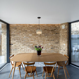 This Is An Example Of A Medium Sized Contemporary Dining Room In London With Concrete Flooring