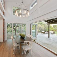 Farmhouse Dining Room by Hughes Construction, Inc