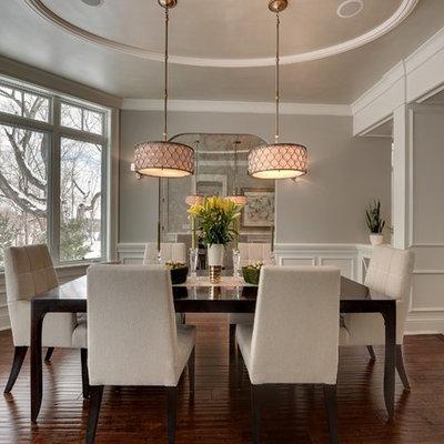 Elegant dark wood floor and brown floor dining room photo in Minneapolis with gray walls