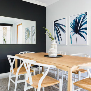 Photo of a nautical enclosed dining room in Sydney with black walls, ceramic flooring and white floors.