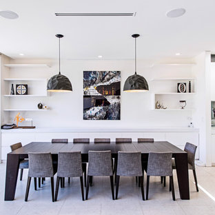 Contemporary kitchen/dining combo in Sydney with white walls and beige floor.