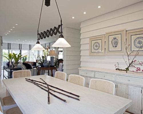 Example Of A Mountain Style Dining Room Design In Other With White Walls