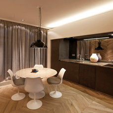 Contemporary Dining Room by PuurFlow