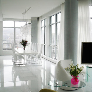 Example of a huge trendy ceramic floor and white floor kitchen/dining room combo design in Montreal with white walls