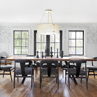 Enclosed dining room - farmhouse medium tone wood floor enclosed dining room idea in Portland with multicolored walls and no fireplace