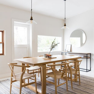 Design ideas for a scandinavian dining room in Sydney with white walls and white floor.