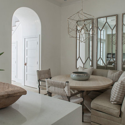 Example of a mid-sized transitional beige floor and travertine floor kitchen/dining room combo design in Nashville with white walls and no fireplace
