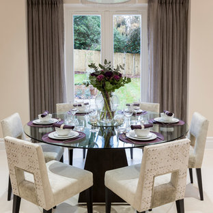 Design ideas for a traditional dining room in Surrey with beige walls.