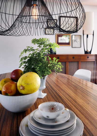 Midcentury Dining Room by embrio design studio