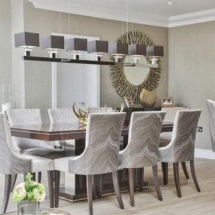 Design ideas for a traditional dining room in Surrey with beige walls, light hardwood flooring, no fireplace and beige floors.