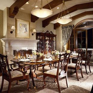 Imagen de comedor clásico, grande, con suelo de madera oscura y chimenea tradicional