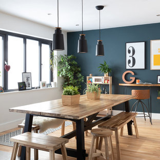 This is an example of a scandinavian kitchen/dining room in Other with white walls, light hardwood flooring and beige floors.