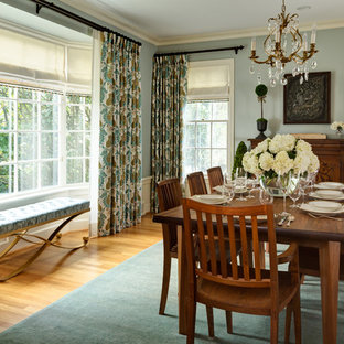 Enclosed dining room - large traditional medium tone wood floor enclosed dining room idea in Portland with blue walls and no fireplace