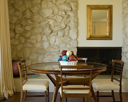 Transitional dark wood floor dining room idea in Los Angeles with beige  walls, a stone